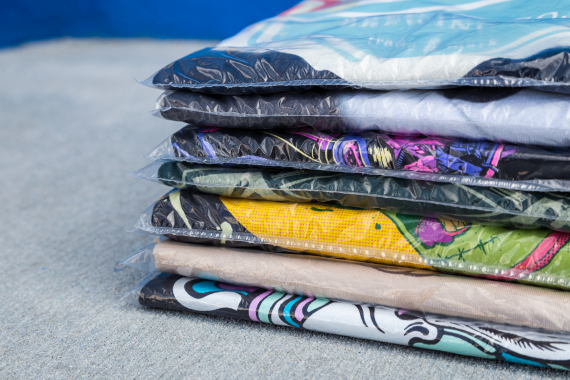 shirts in a bag stacked up