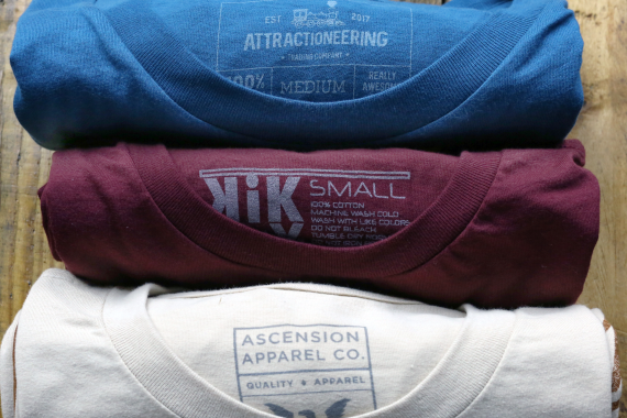 three shirts rolled up showing their tagless labels